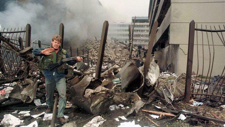 Ravage in Nairobi na de aanslagen in augustus 1998. Anas al-Liby, een van de bedenkers en uitvoerders van de aanslagen is in Tripoli, Libië door Amerikaanse elitetroepen opgepakt. Beeld Reuters