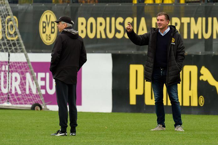 Borussia-trainer Lucien Favre (l) en technisch directeur Michael Zorc.