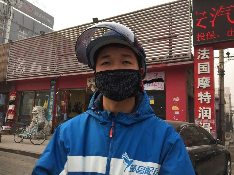 Bezorger Huang. Beeld Rechtenvrij