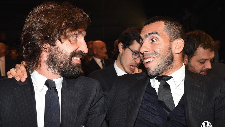 Andrea Pirlo (links) met Juve-ploegmaat Carlos Tevez, die ook deel uitmaakt van de Serie A-ploeg van het jaar.