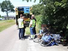 Vrachtwagenchauffeur ziet jonge fietser over het hoofd in Schaijk; jongen gewond