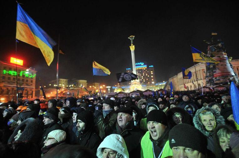 Antiregeringsdemonstranten gisteren in Kiev op het Onafhankelijkheidsplein. Beeld afp
