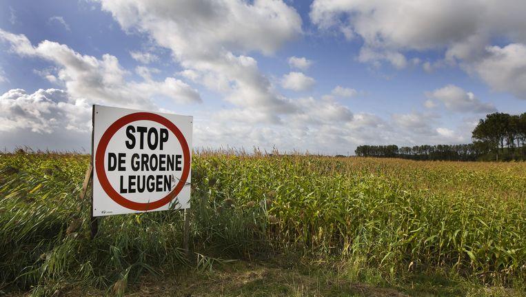 Een protestbord tegen ontpolderen in de Nederlandse Hedwigepolder . Beeld ANP XTRA
