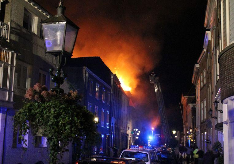 De brandweer blust een brand in een theater in Grave. Beeld anp
