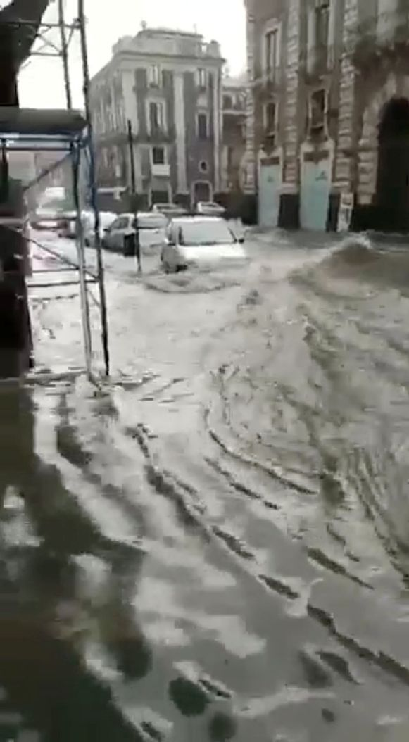 Floodwaters are seen along a street in Catania, Italy October 4, 2018 in this still image obtained from a social media video. Tony Gullotta/via REUTERS THIS IMAGE HAS BEEN SUPPLIED BY A THIRD PARTY. MANDATORY CREDIT. NO RESALES. NO ARCHIVES. MANDATORY CREDIT  TONY GULLOTTA