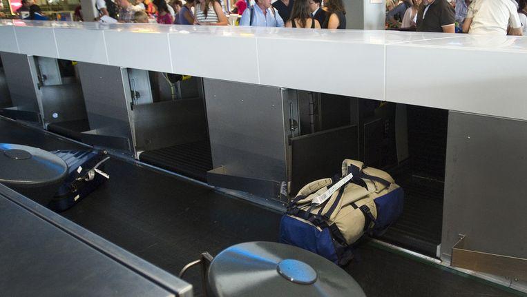 Een bagageband op de luchthaven Schiphol Beeld anp