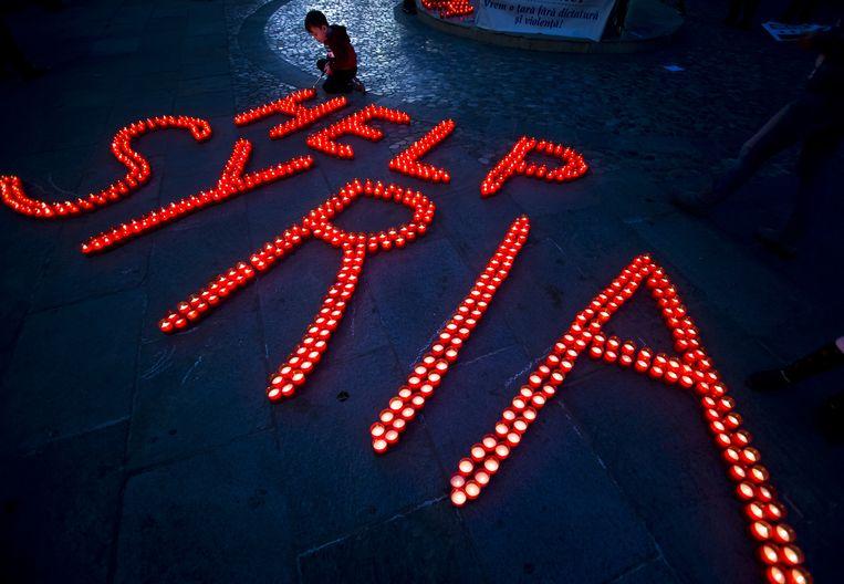 Vreedzaam protest in Boekarest op maandag. Beeld ap