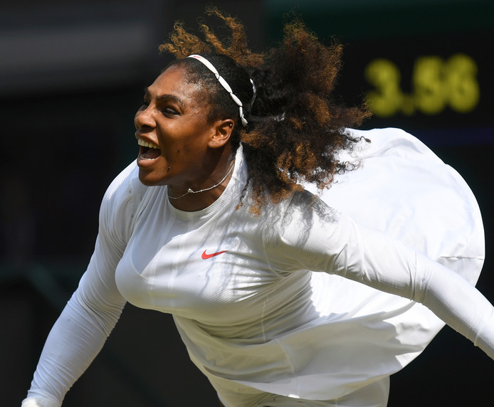 Serena Williams of the US serves to Julia Goerges of Germany during their women's semifinal match at the Wimbledon Tennis Championships in London, Thursday July 12, 2018. (Neil Hall/Pool via AP)