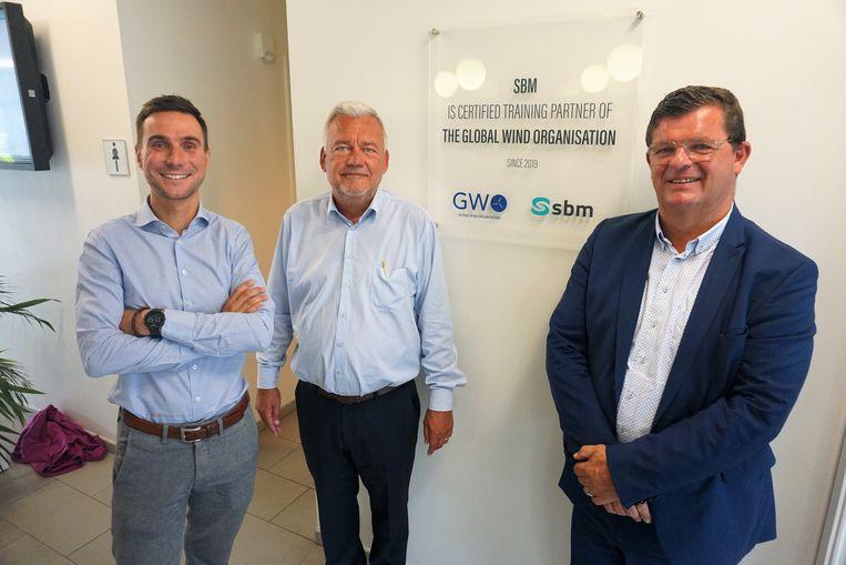 (vlnr) Filip Roelandt, Johan De Neve en burgemeester Bart Tommelein bij de inhuldiging van het opleidingscentrum van Syntra.