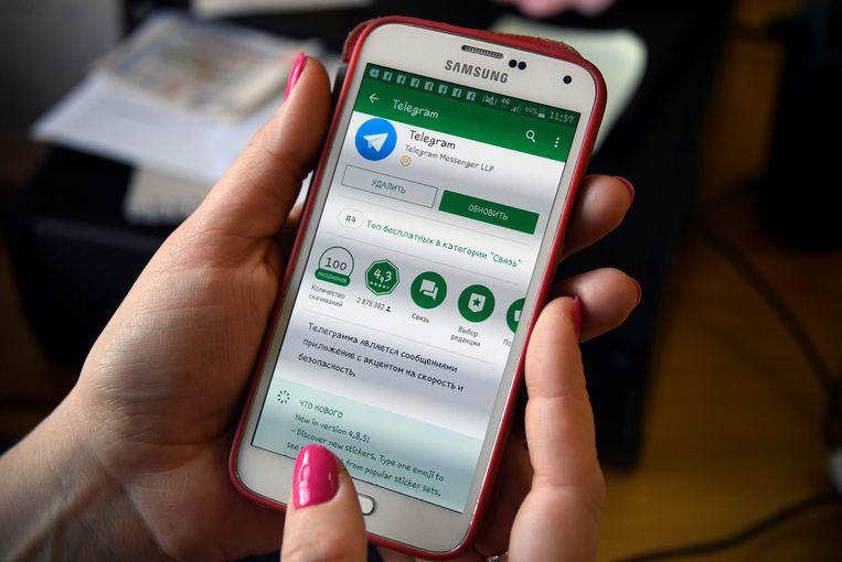 Een smartphone met de berichtenservice Telegram. Beeld AFP