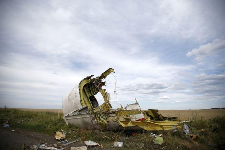 Een stuk van het wrak van MH17 nabij het Oekraïense dorp Hrabove. Beeld Reuters