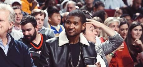 Usher bedolven onder twee basketballers bij NBA-topper