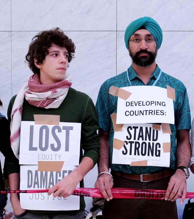 Activisten tijdens de klimaattop in Doha. Beeld ap