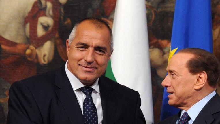De Bulgaarse premier Bojko Borisov tijdens een ontmoeting vorig jaar met de Italiaanse premier Silvio Berlusconi. © epa Beeld
