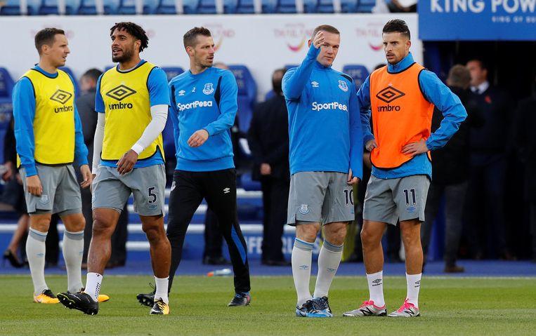 Mirallas in conclaaf met Rooney.