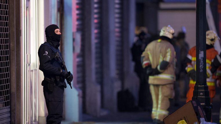 Huiszoekingen in Brussel na de aanslagen in Parijs. Beeld photo_news