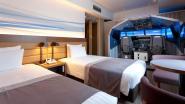 In dit Japans hotel krijg je er een professionele vliegtuigsimulator bij op je kamer