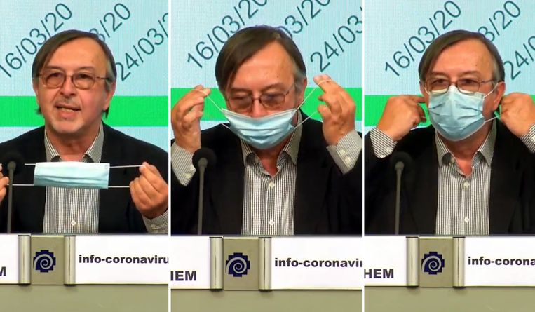Yves Van Laethem demonstreert het gebruik van een mondmasker.