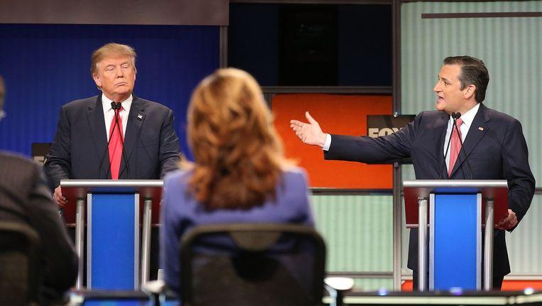 Donald Trump en Ted Cruz in het Republikeinse presidentsdebat. Beeld afp