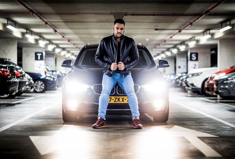 DEN HAAG - Eduard Nandelall bij zijn BMW in Den Haag. FREEK VAN DEN BERGH Beeld