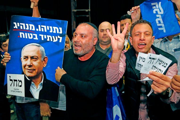Aanhangers van de Likud-partij in aanloop naar de verkiezingsuitslag. Beeld AFP. Beeld AFP