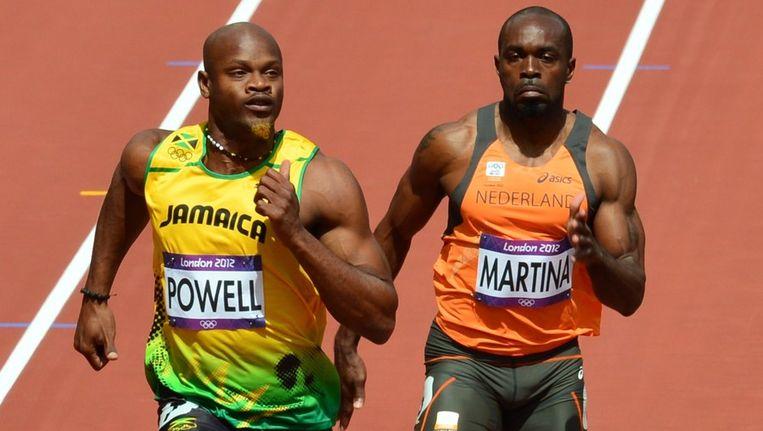 Churandy Martina finisht als derde in zijn serie. Asafa Powell wint.. Beeld afp
