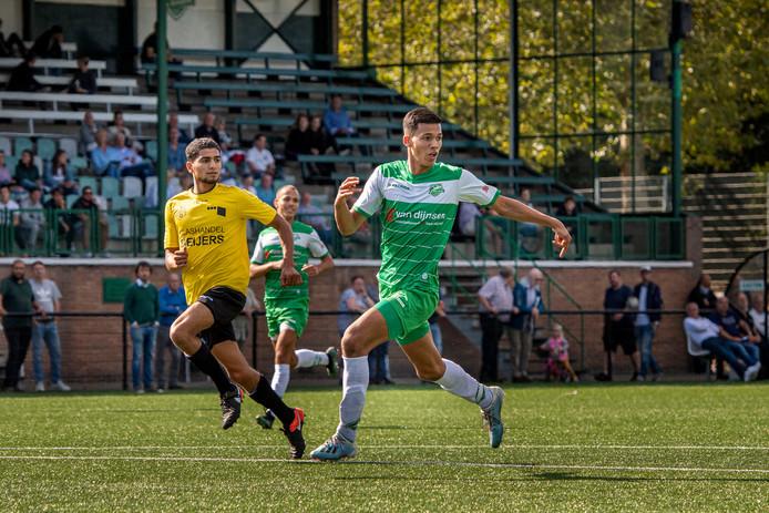 Baronie-speler Yassine Mejres (groen shirt) maakte gisteren de enige treffer van de wedstrijd.