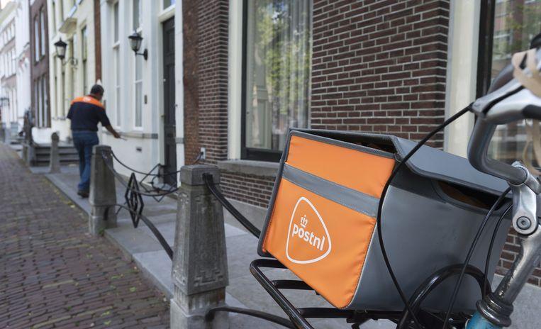 Postbezorging in de regio Delft. Beeld anp