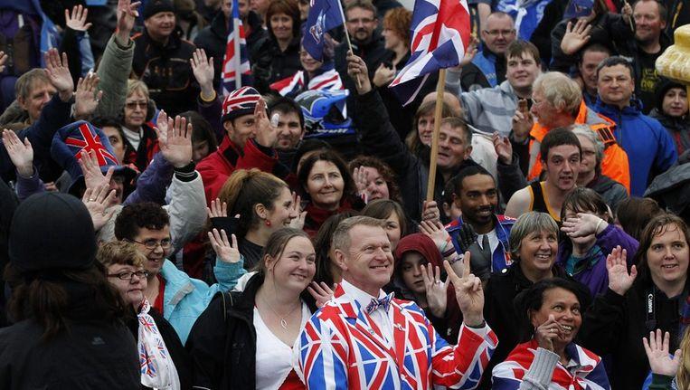 Bewoners van de Falklandeilanden laten daags voor het referendum zien dat ze graag Brits willen blijven. Beeld epa