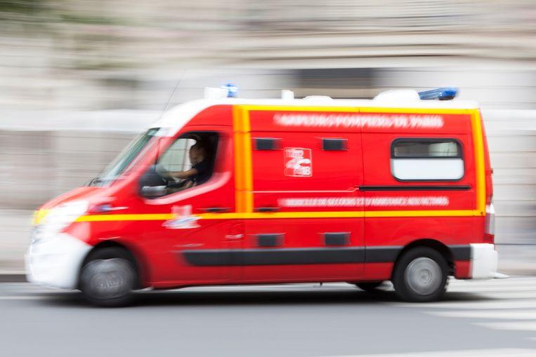 Speeding emergency ambulance on a city street