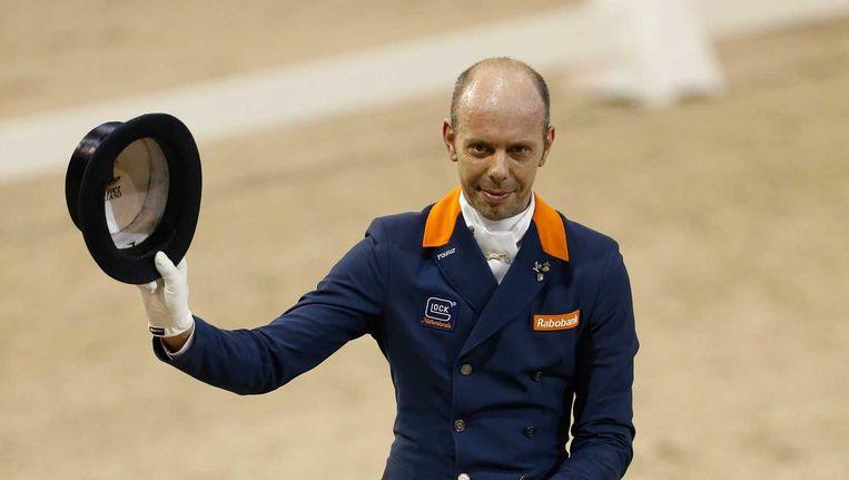 Winnaar Hans Peter Minderhoud op zijn paard Glock's Flirt. Beeld anp