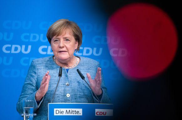 Merkel tijdens de persconferentie van haar partij.