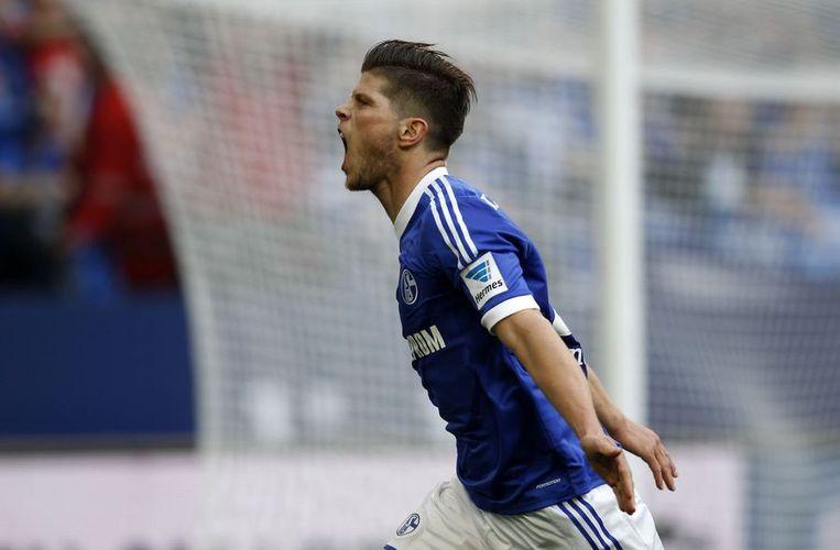 Klaas-Jan Huntelaar juicht na een van zijn goals tegen Hoffenheim Beeld null