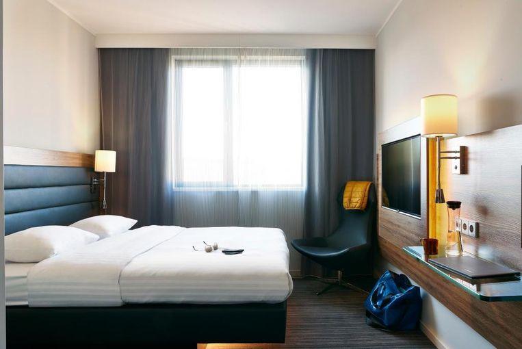 Een moderne hotelkamer van de keten Moxy, onderdeel van Marriott.