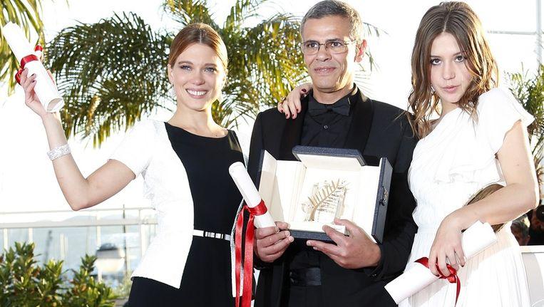 De winnaars van de Gouden Palm 2013: actrice Léa Seydoux, regisseur Abdellatif Kechiche en actrice Adèle Exarchopoulos. Beeld epa