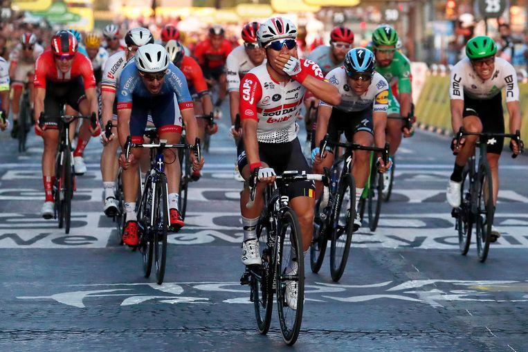 De Australiër Caleb Ewan (midden) van Lotto-Soudal is met drie zeges de sprintkoning van de Tour geworden.  Beeld EPA