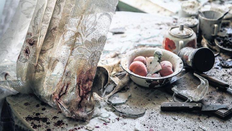 Keukentafel na gevechten in de Oekraïense stad Donetsk. Beeld epa