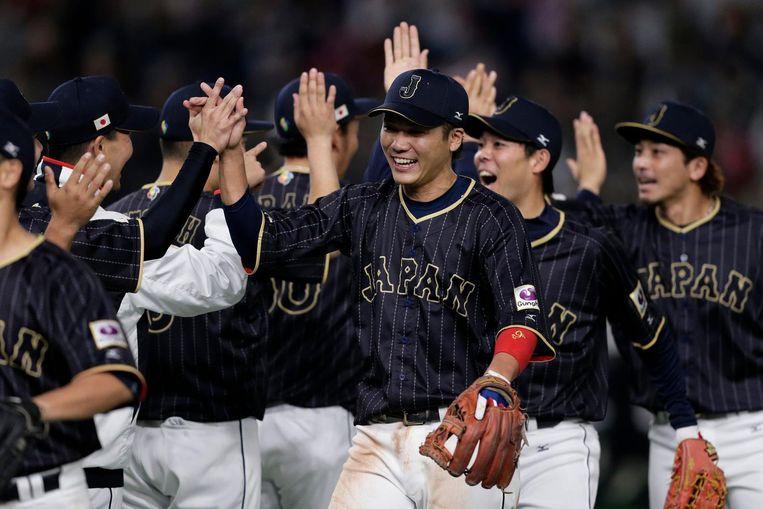 De Japanners vieren de overwinning Beeld ap