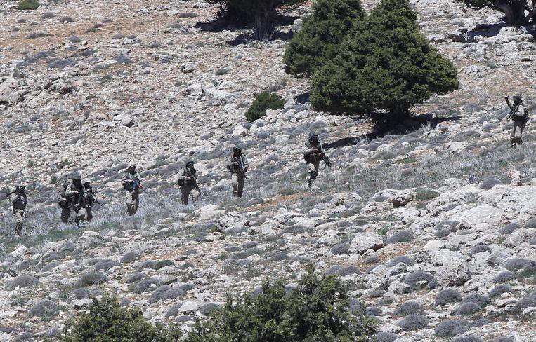 Strijders van Hezbollah in Khashaat in Mongolië. Beeld null