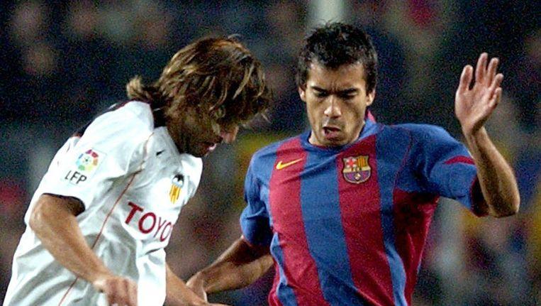 Giovanni van Bronckhorst in het shirt van Barcelona Beeld epa