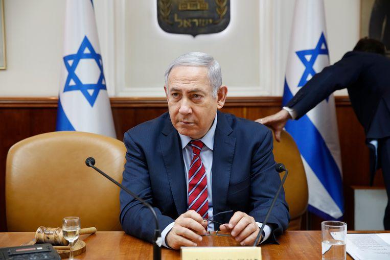 Israëlische premier Benjamin Netanyahu tijdens een van de wekelijkse kabinetsvergaderingen in Jeruzalem vlak na de demonstraties in Tel Aviv. Beeld ANP