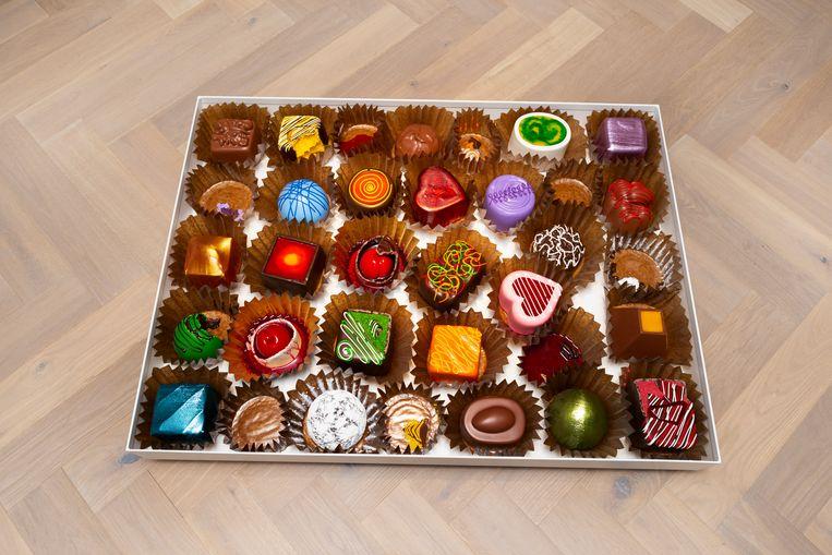 In het museum dreig je te struikelen over een reusachtige doos bonbons. Beeld Pauline Niks