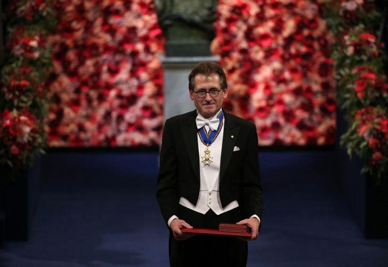 Ben Feringa tijdens de uitreing van de Nobelprijs. Beeld afp