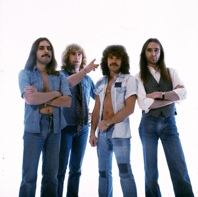 Status Quo in 1979, met geheel rechts Francis Rossi en tweede van links Rick Parfitt. Beeld Getty