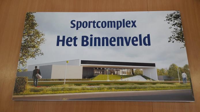 Ontwerp van sportcomplex Het Binnenveld in Wageningen. Op de voorgrond de kunstgrasvelden, daarachter de sporthal.