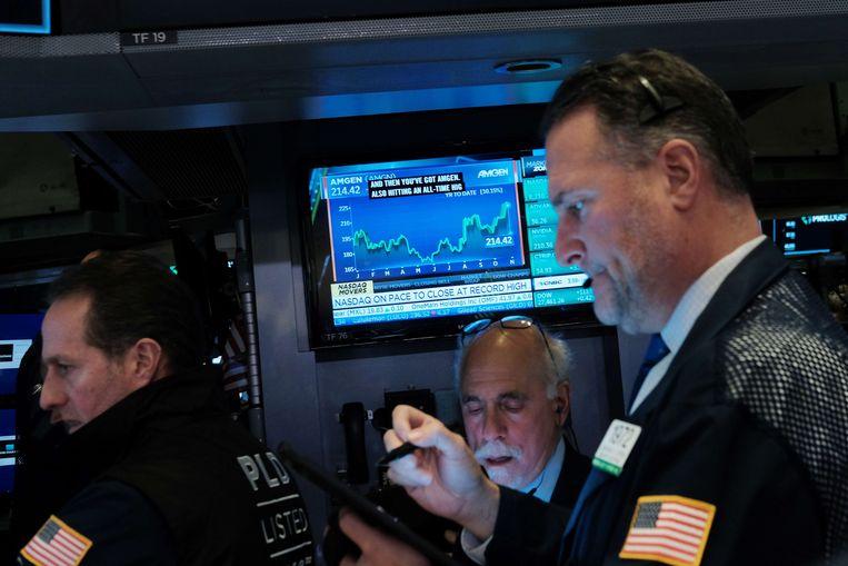 Beurshandelaren op de New York Stock Exchange maandag. Ook op Wall Street werden deze week records gebroken.