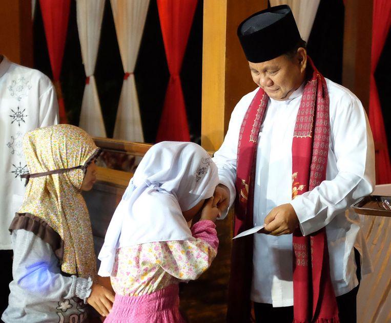 Ex-generaal Prabowo in juli bij een ceremonie. Nu zet hij Widodo de voet dwars. Beeld Olivia Rondonuwu / AFP