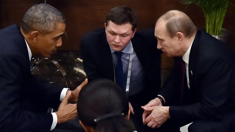 Obama (links) en Poetin (rechts) zaterdag op de G20 in Antalya. Beeld afp