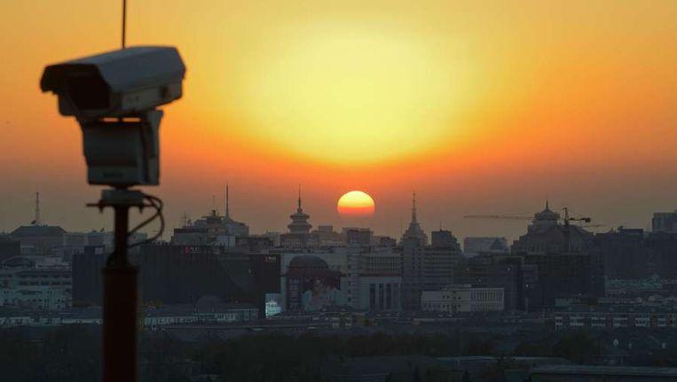 Een beveiligingscamera in Beijing. Beeld afp