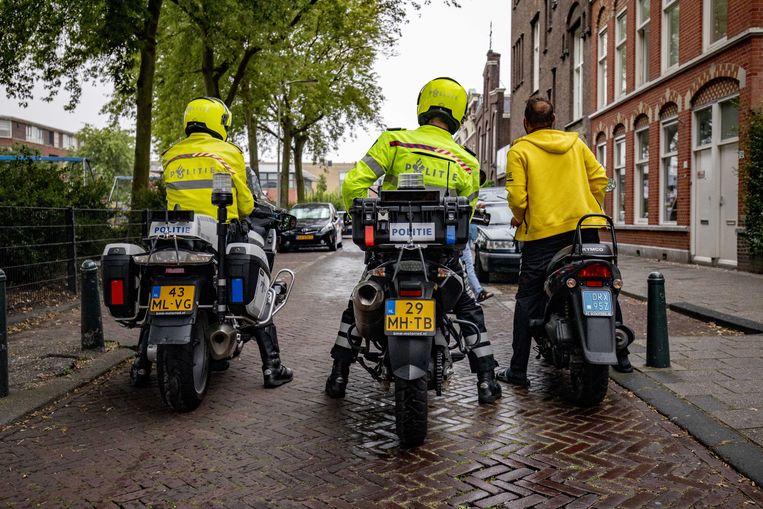 De politie is paraat in de Schilderswijk. Beeld ANP